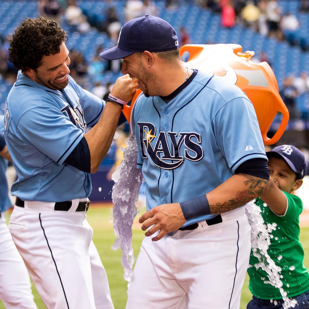 Cabrera's son, Meyer, helps DeJesus with the celebratory ice bath/ANDREW J. KRAMER