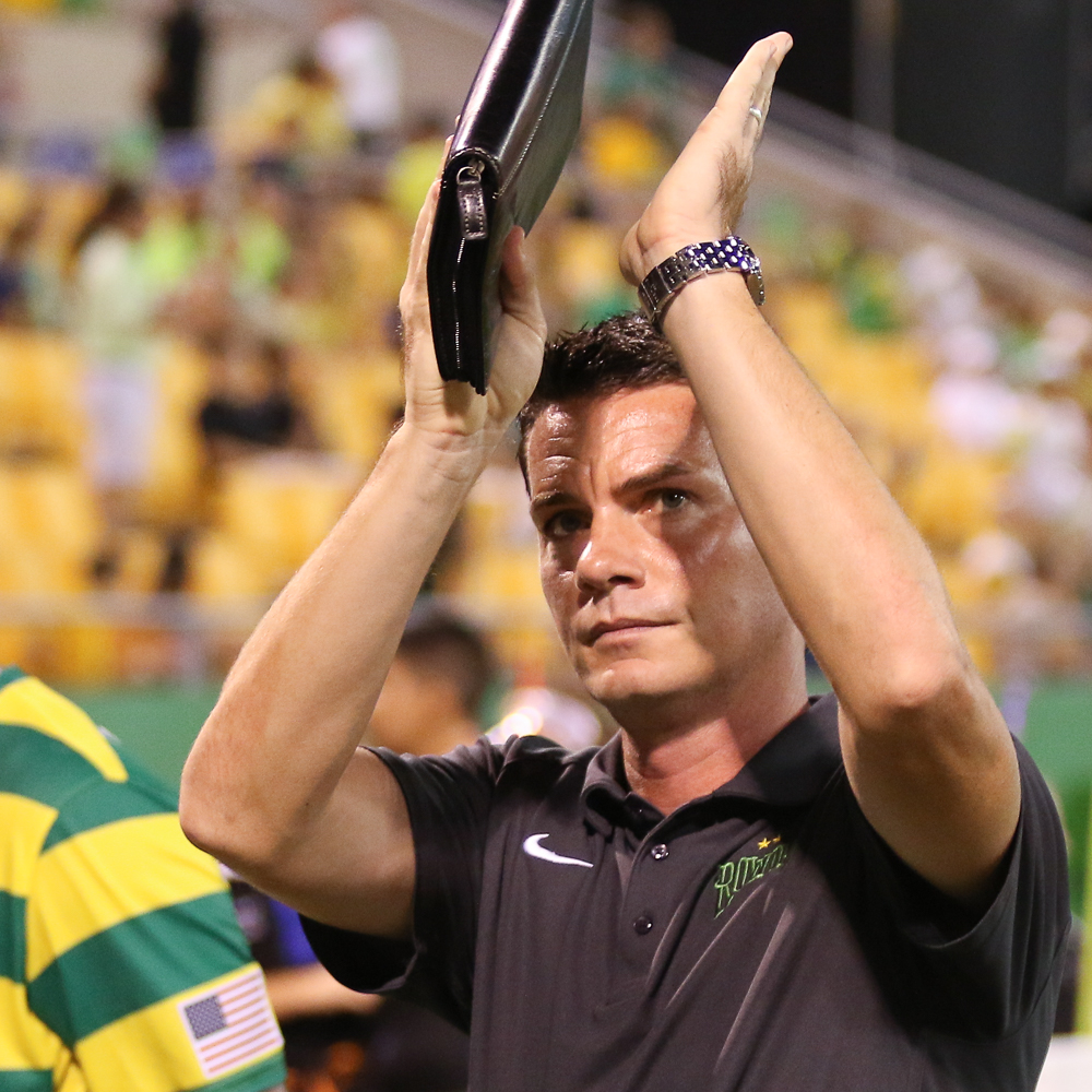 Rowdies interim head coach Stuart Campbell applauds the fans after the 3-1 loss to Minnesota/ANDREW J. KRAMER