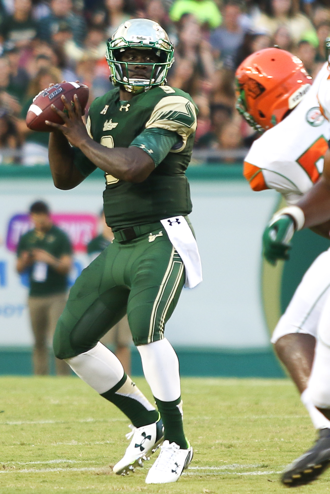 Quinton Flowers had himself a day with 1 passing and 2 rushing touchdowns/ANDREW J. KRAMER