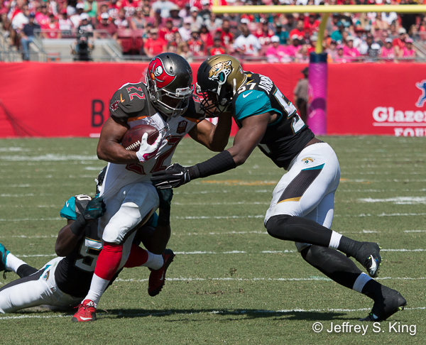 Doug Martin fights for yardage on is 123-yard day.