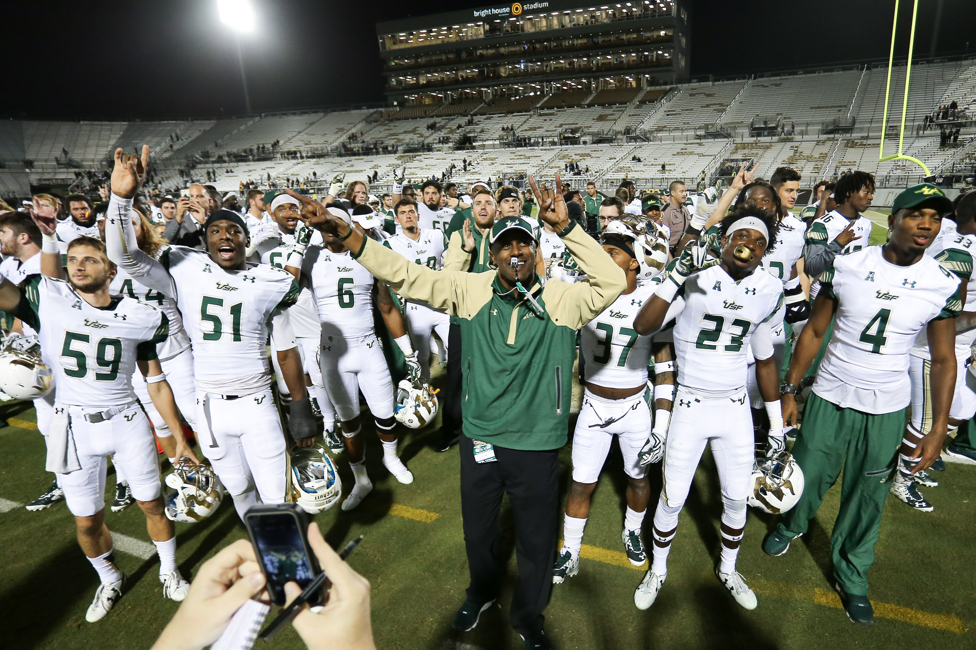 Taggart and the Bulls celebrate after defeating UCF 44-3./ANDREW J. KRAMER