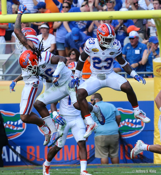 Gators go sky-high in celebrating a goal-line stand./JEFFREY S. KING
