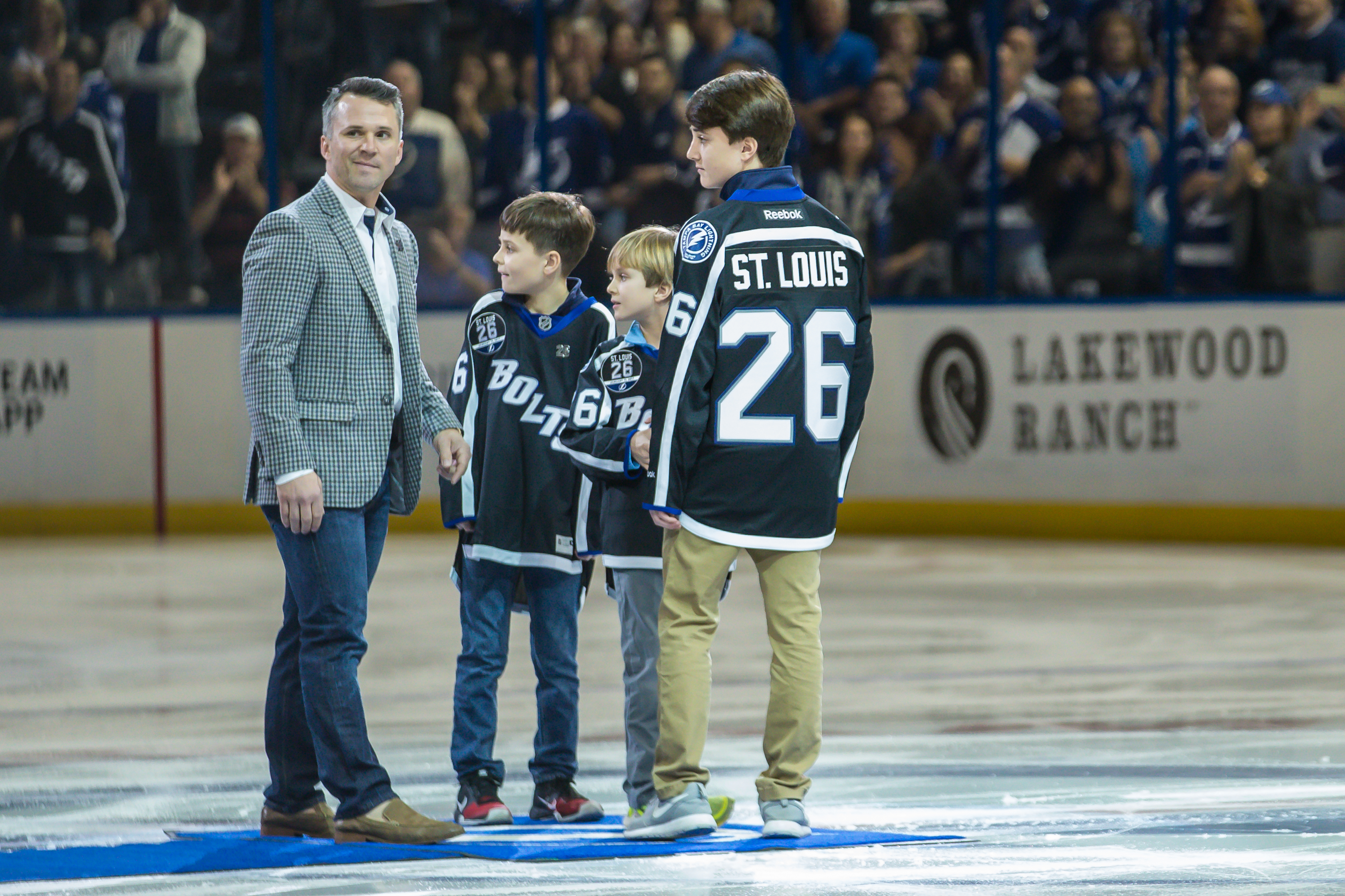 St. Louis and his three sons drop the puck for the Bolts./TRAVIS PENDERGRASS