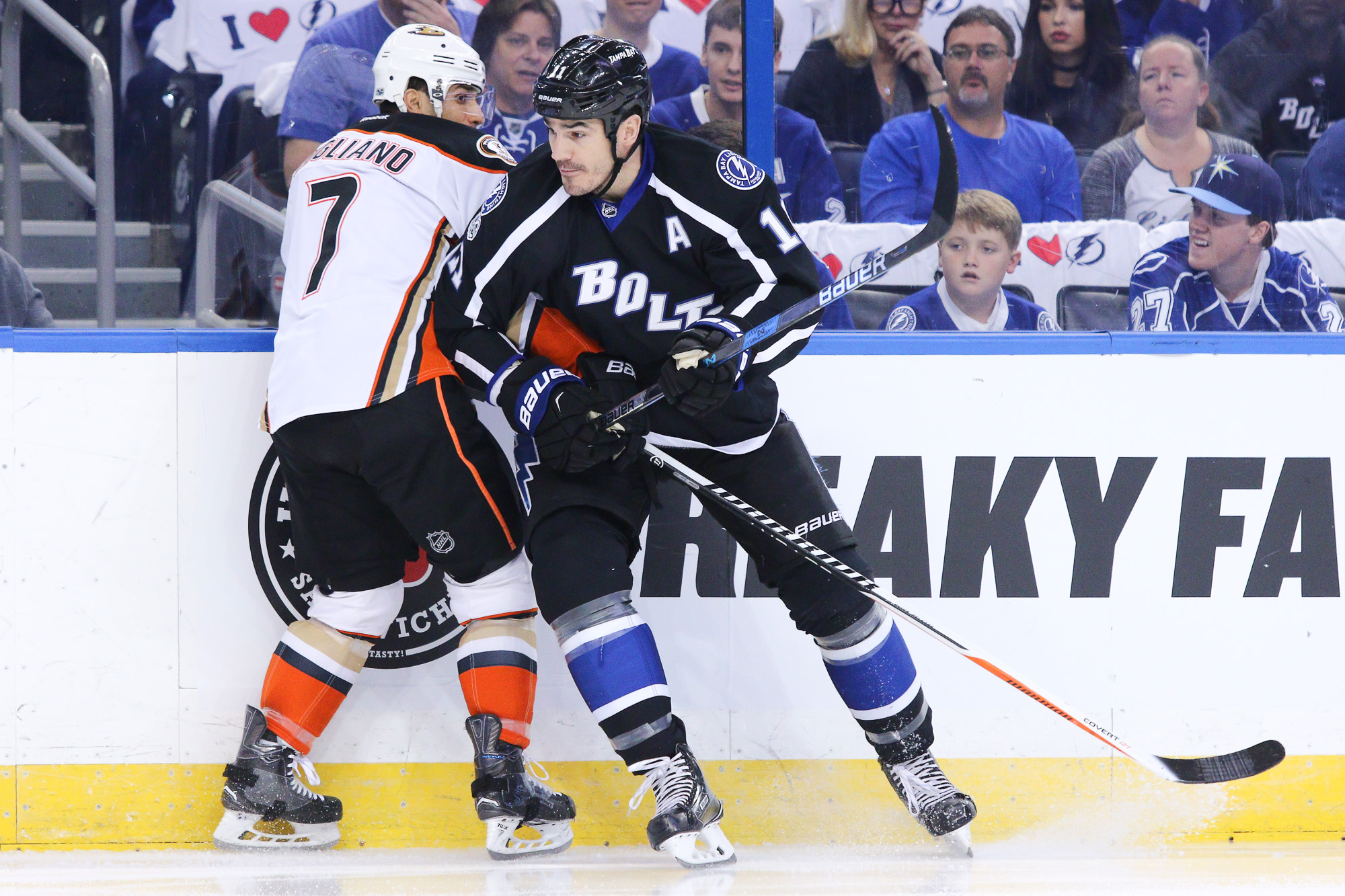 Boyle battles along the boards with Cogliano/ANDREW J. KRAMER