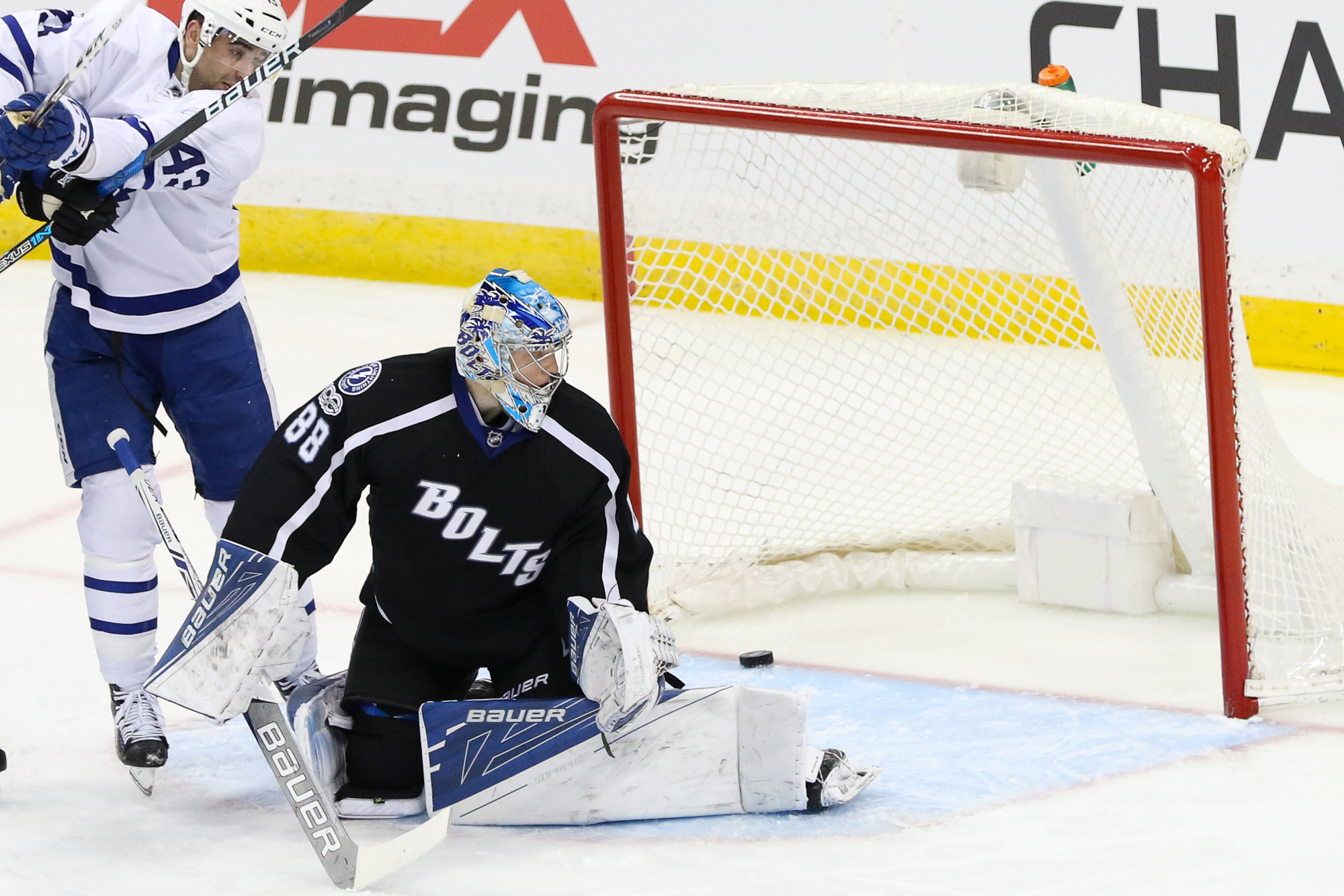 Andrei Vasilevskiy watches as a puck gets past him./Steven Muncie