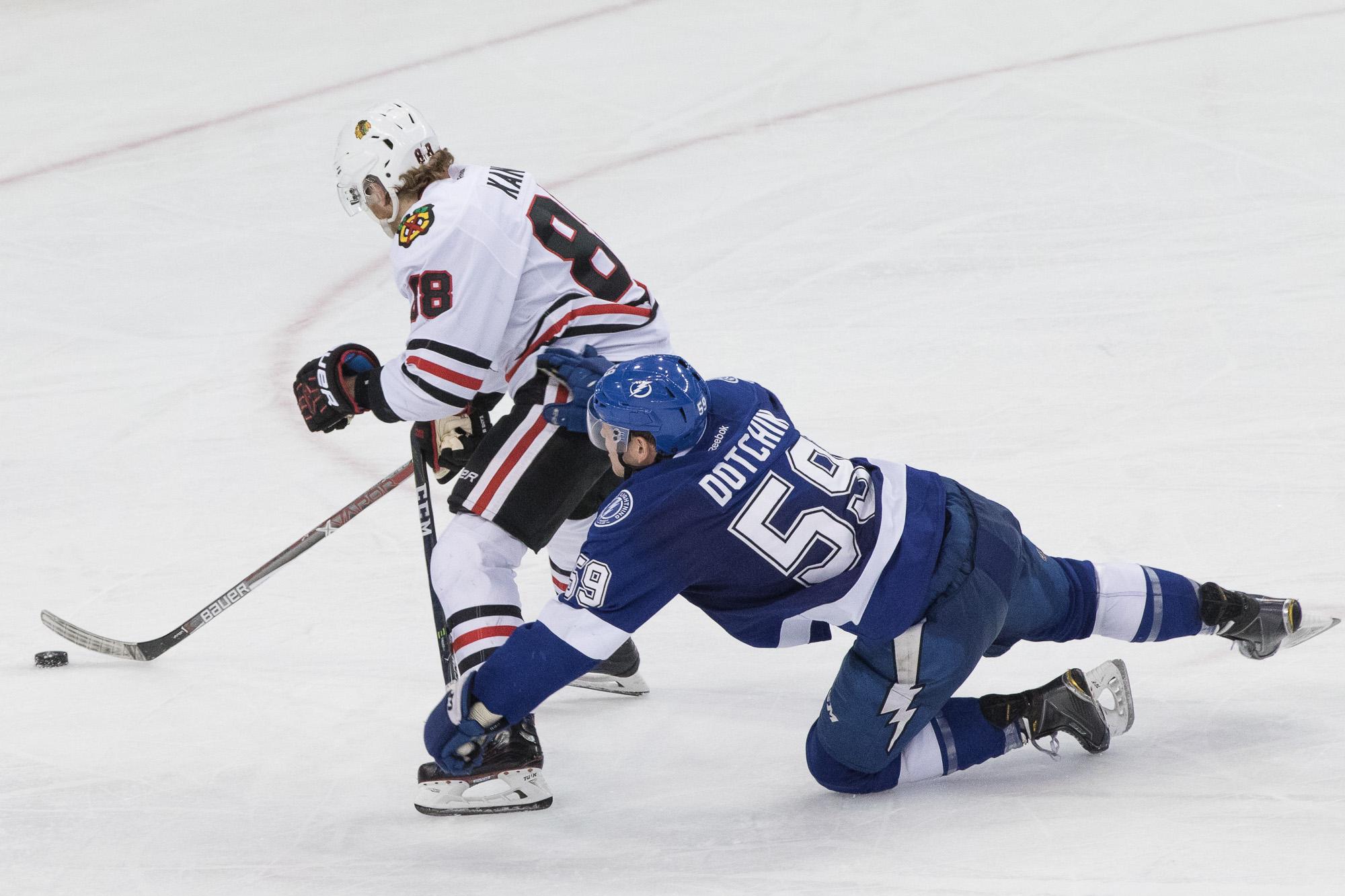 Jake Dotchin tries to stop Kane./Steven Muncie