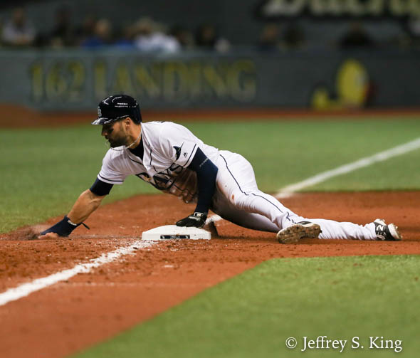 Rays' Kevin Kiermaier steals third in Tampa Bay victory./JEFFREY S.  KING