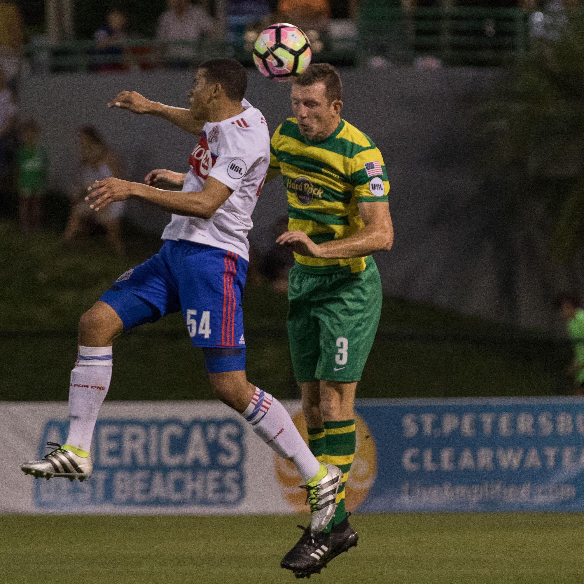 Neill Collins heads the ball./Steven Muncie