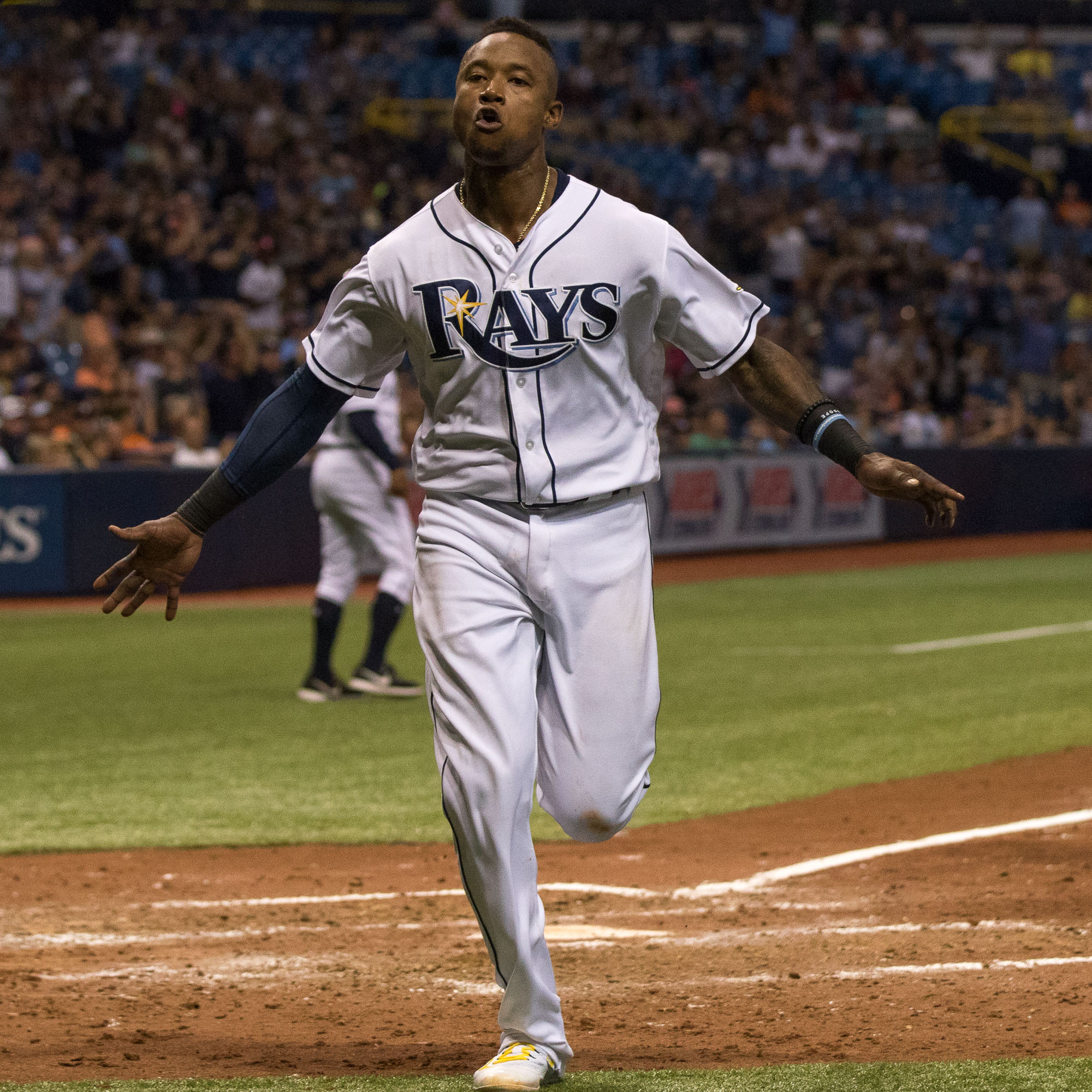 Tim Beckham celebrates a two-run homer that led the Rays to their win./STEVEN MUNCIE