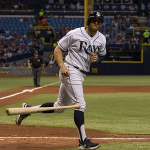 Miller tosses the bat on his way to first../STEVEN MUNCIE