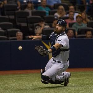 Derek Norris unsuccessfully tries to catch a foul ball./STEVEN MUNCIE