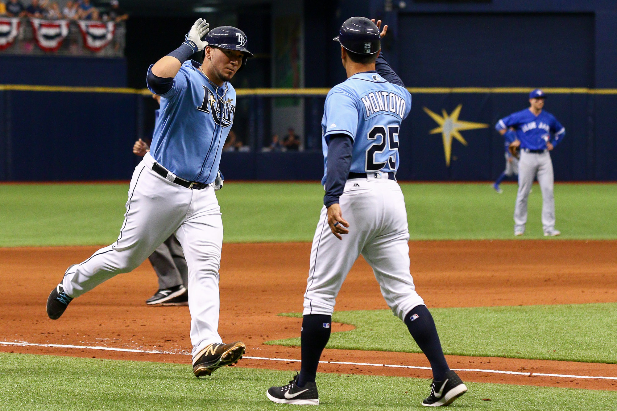 Jesús Sucre rounds the bases after hitting a solo home run in the 4th - his first hit as a Ray./ANDREW J. KRAMER