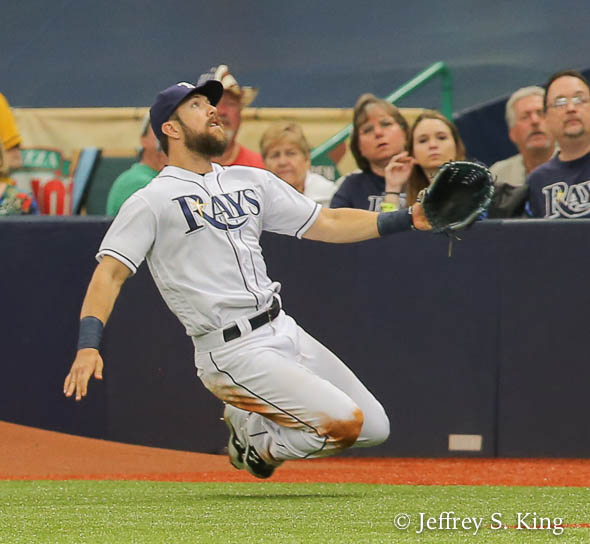 Souza makes sliding catch in Rays' big win./JEFFREY S. KING