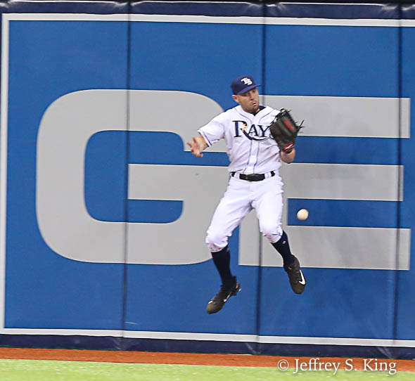 Rays' centerfielder Peter Bourjos can't come up with a big catch in the eighth./JEFFREY S. KING