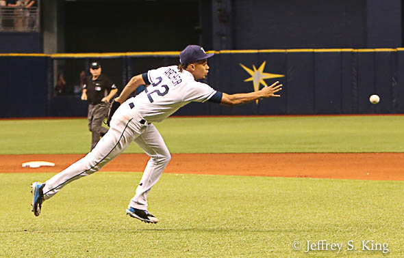 Archer flips the ball to first for a force-out./JEFFREY S. KING