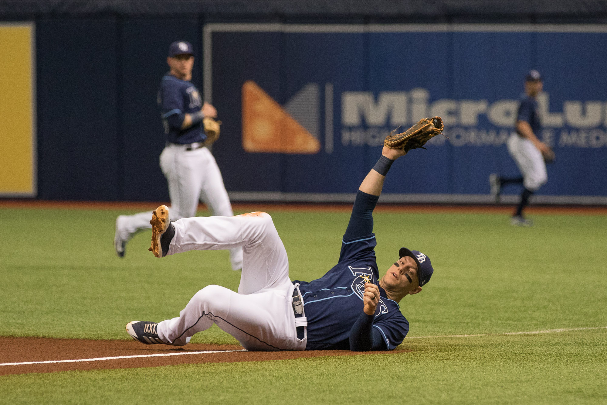 Logan Morrison makes a sliding catch to get an out./STEVEN MUNCIE