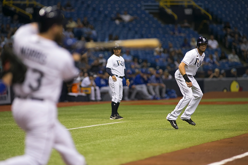 Rasmus (on base) tripled to start the second, but watched the Rays' side strike out./CARMEN MANDATO