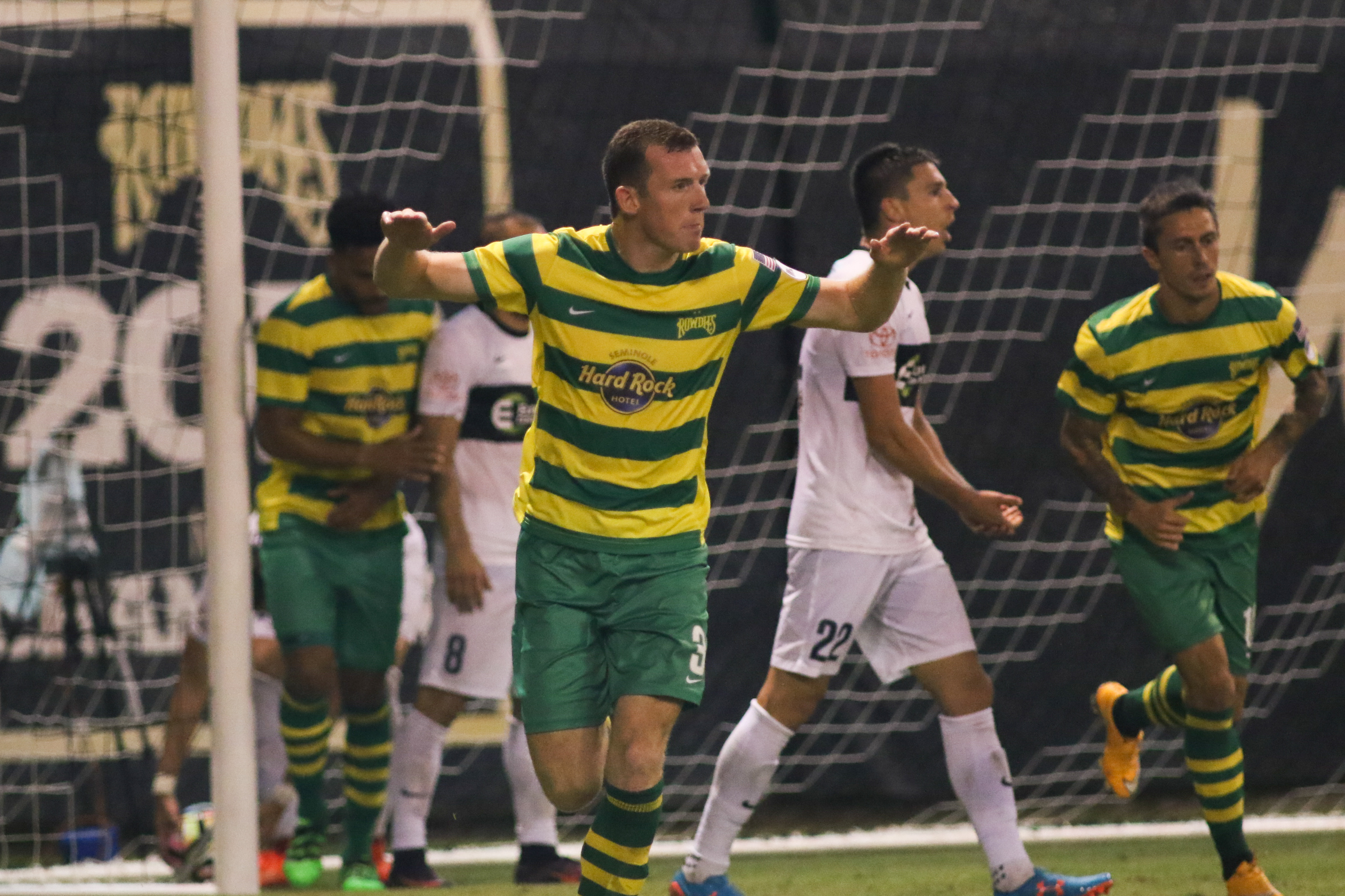 Neal Collins celebrates after his header tied the game./CARMEN MANDATO