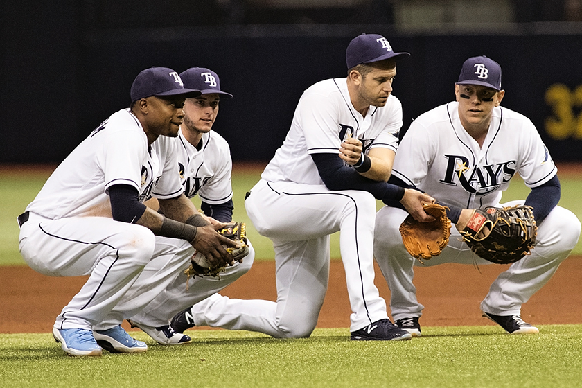 The Rays infielders wait out a pitching change./CARMEN MANDATO