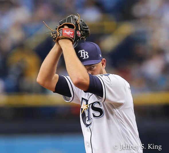 Matt Andriese sneaks a peek at home plate./JEFFREY S. KING