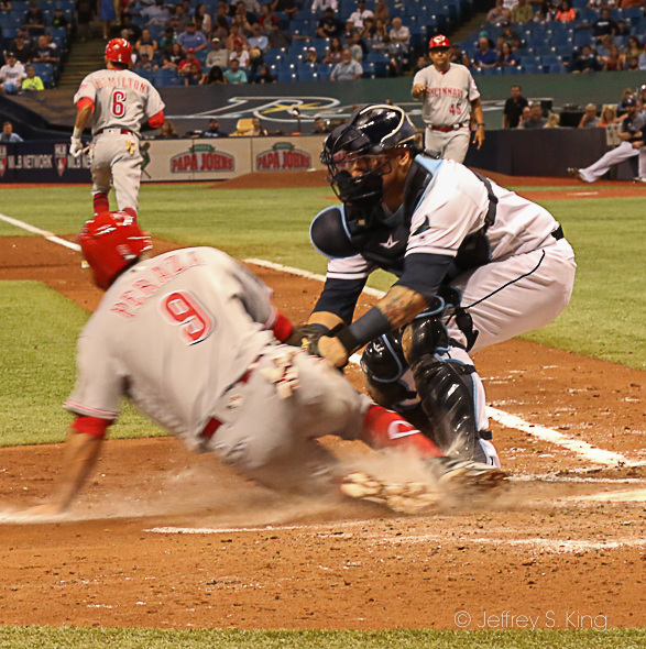 Sucre puts the tag on Jose Peraza at home plate./JEFFREY S. KING