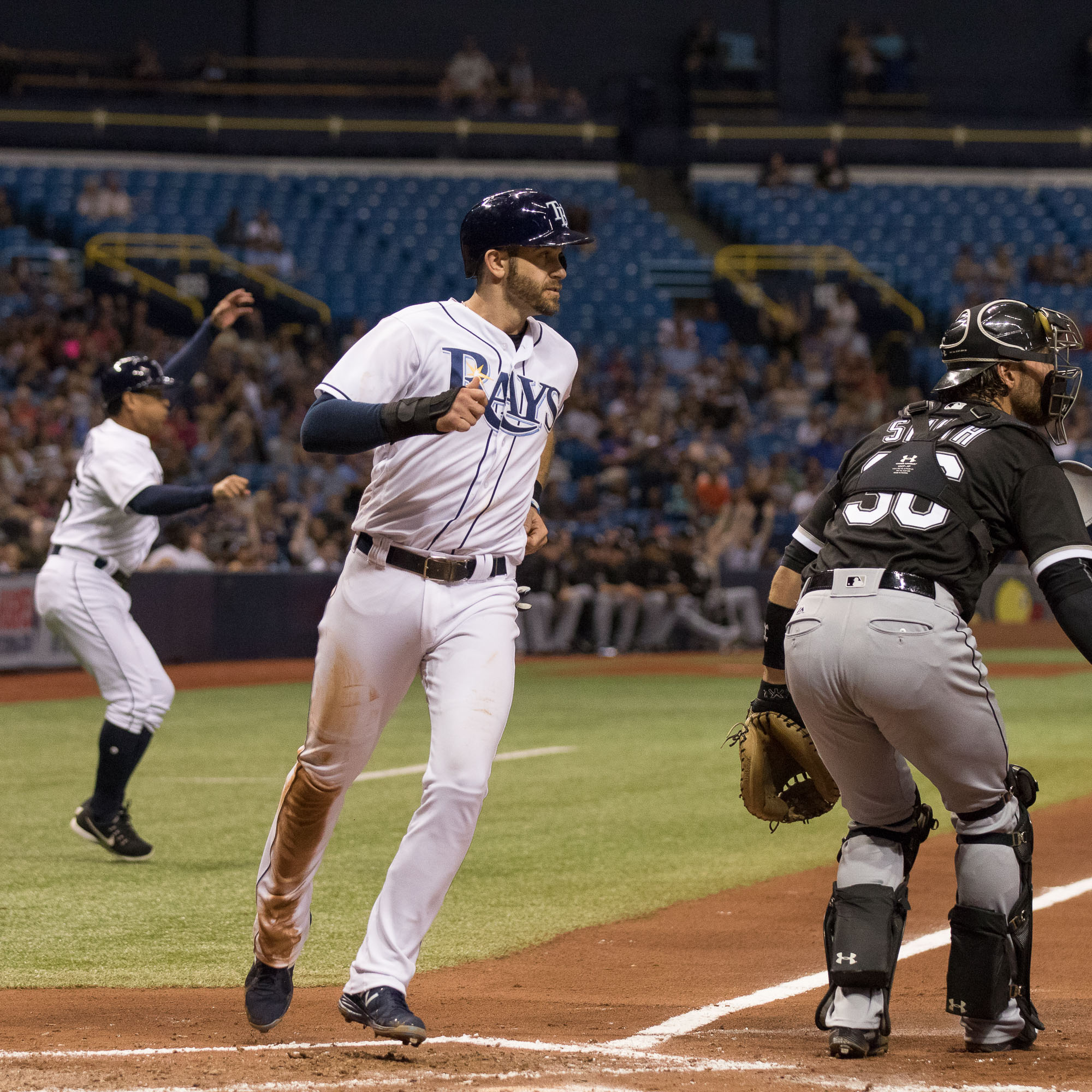 Evan Longoria scores a run in the Rays' 3-1 victory./STEVEN MUNCIE