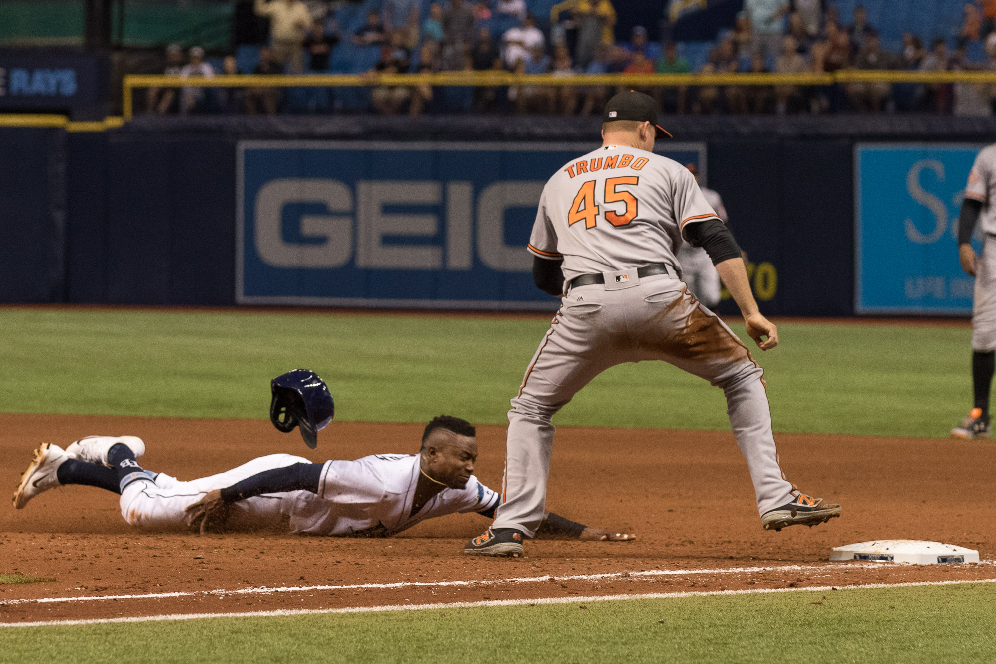 Tim Beckham attempts to slide back to first but is doubled off./STEVEN MUNCIE