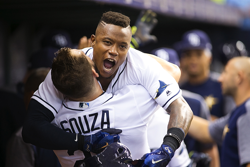 Beckham's three-run homer earned a bear hug from Souza./CARMEN MANDATO