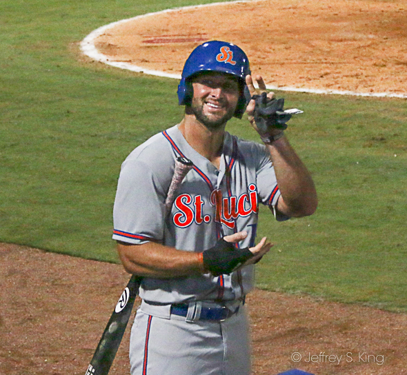 Tebow waves to his fans in the crowd./JEFFREY S. KING