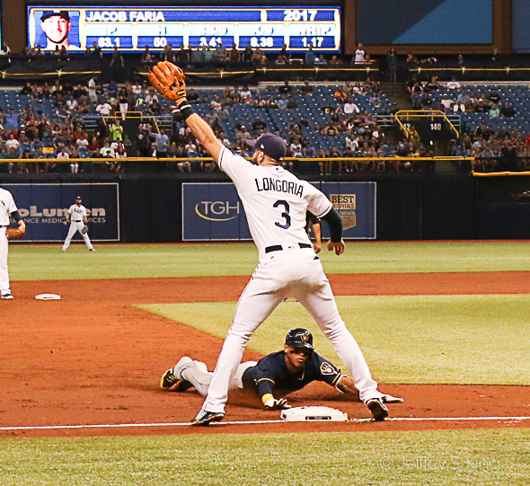 Arcia slides underneath Longoria for a triple in the third./JEFFREY S. KING.