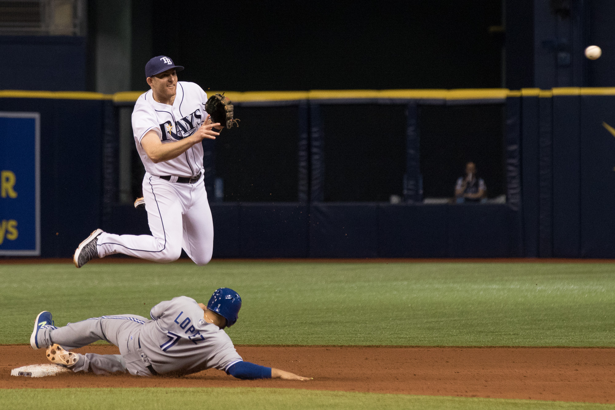 Brad Miller gpes airborne to get a double play./STEVEN MUNCIE