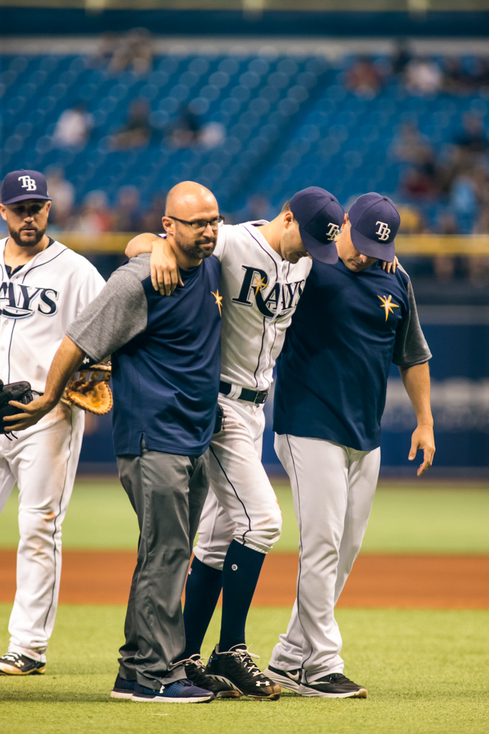 Odorizzi is helped to the dugout after being it by a line drive./CARMEN MANDATO