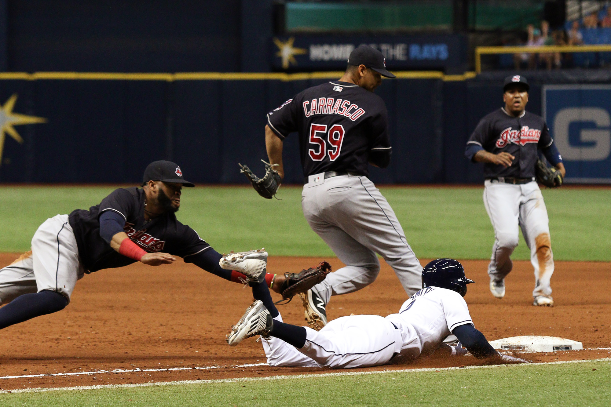 Smith safely slides into first in the 8th/ANDREW J. KRAMER