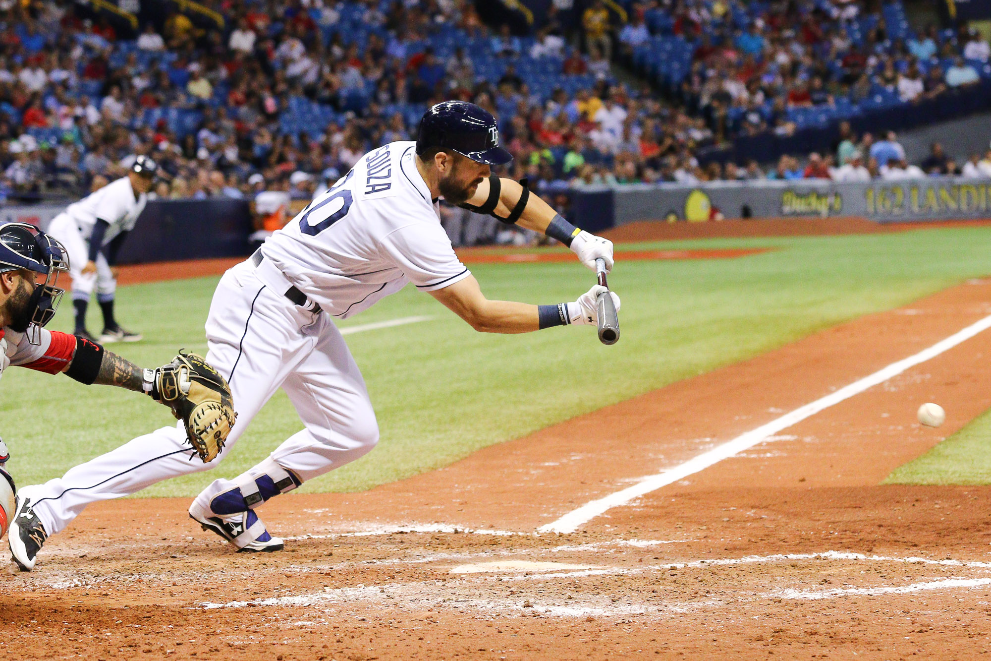 Souza tries bunting his way aboard in the Rays' loss./ANDREW J. KRAMER