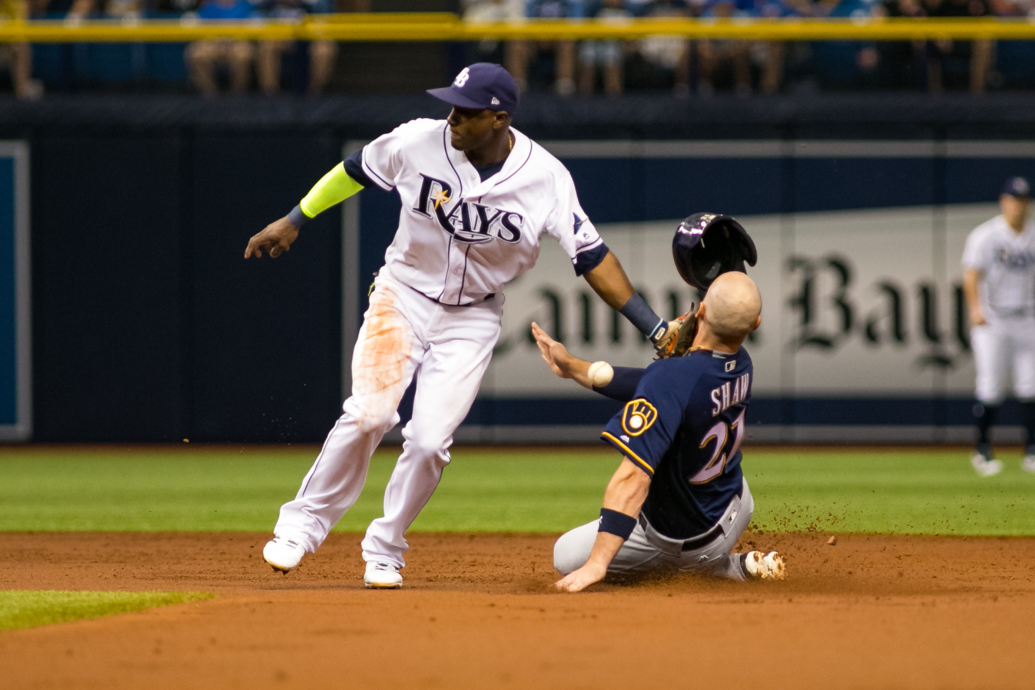 Shaw was hit by Hechavarria's glove and the ball while stealing./CARMEN MANDATO
