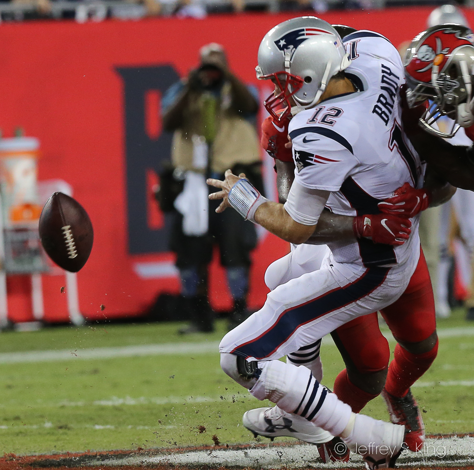 Will Clarke sacks Brady and forces a fumble./JEFFREY S. KING
