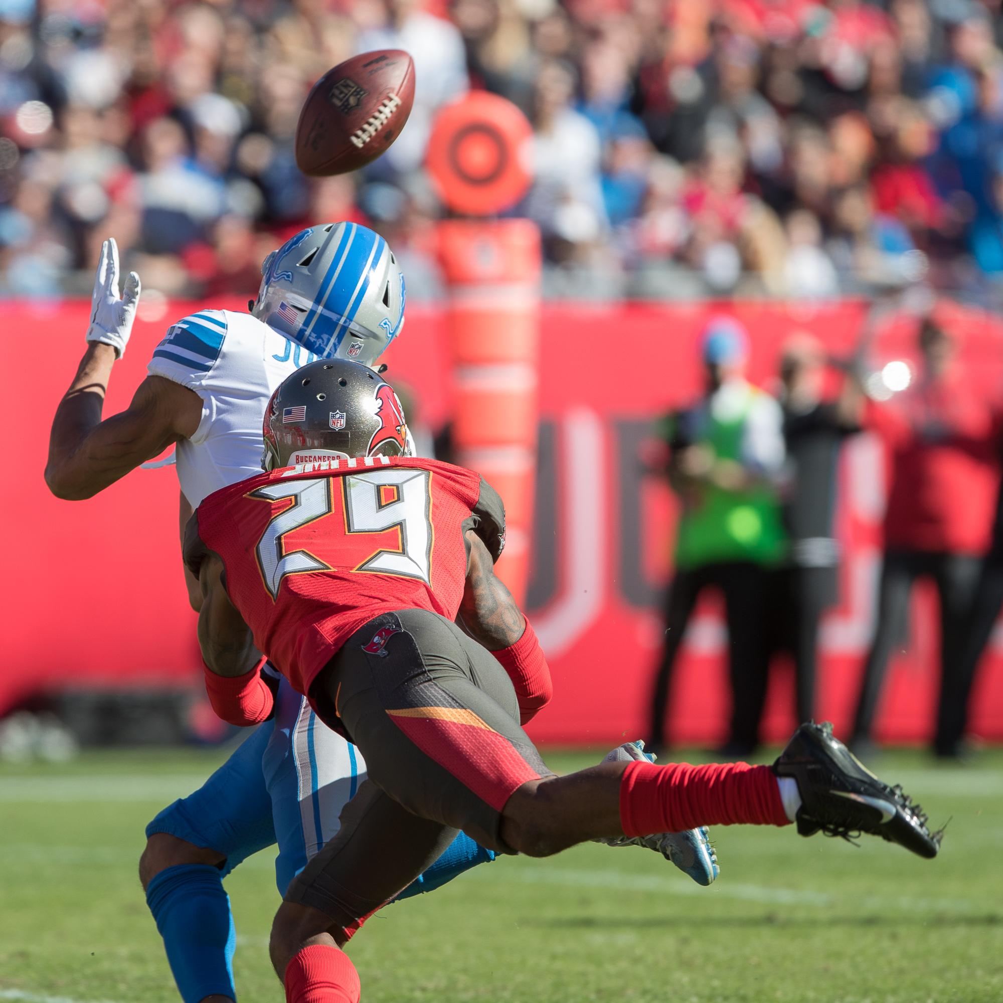 Ryan Smith attempts to stop a catch by Jones./STEVEN MUNCIE