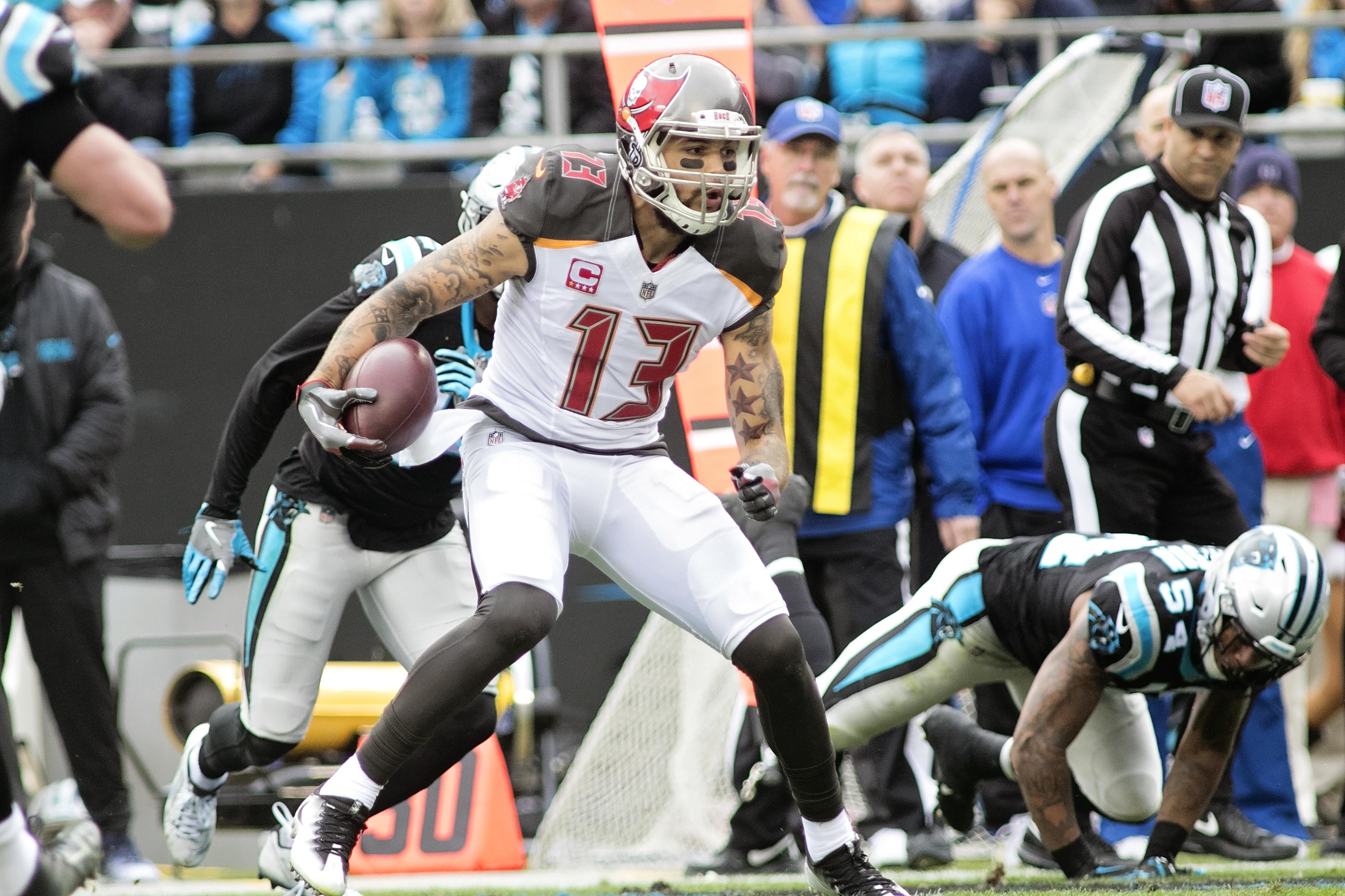 Evans caught six for 107 yards on Sunday./CARMEN MANDATO