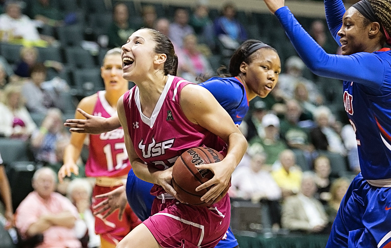Flores is fouled on her wa tot the basket/CARMEN MANDATO