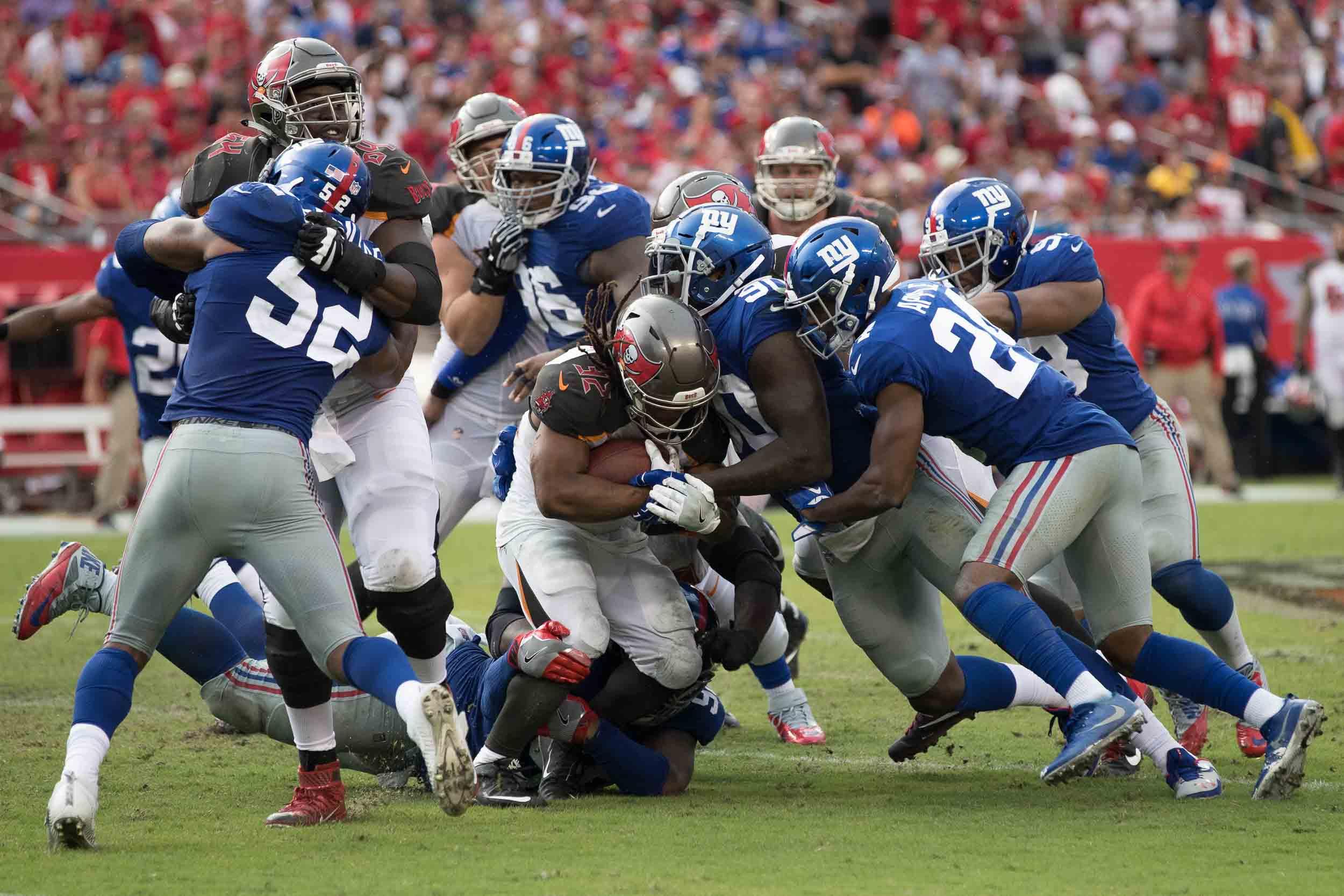 Pierre-Paul makes a tackle against the Bucs./STEVEN MUNCIE
