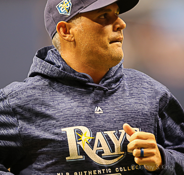 Cash runs off the field for the Rays./JEFFREY S. KING
