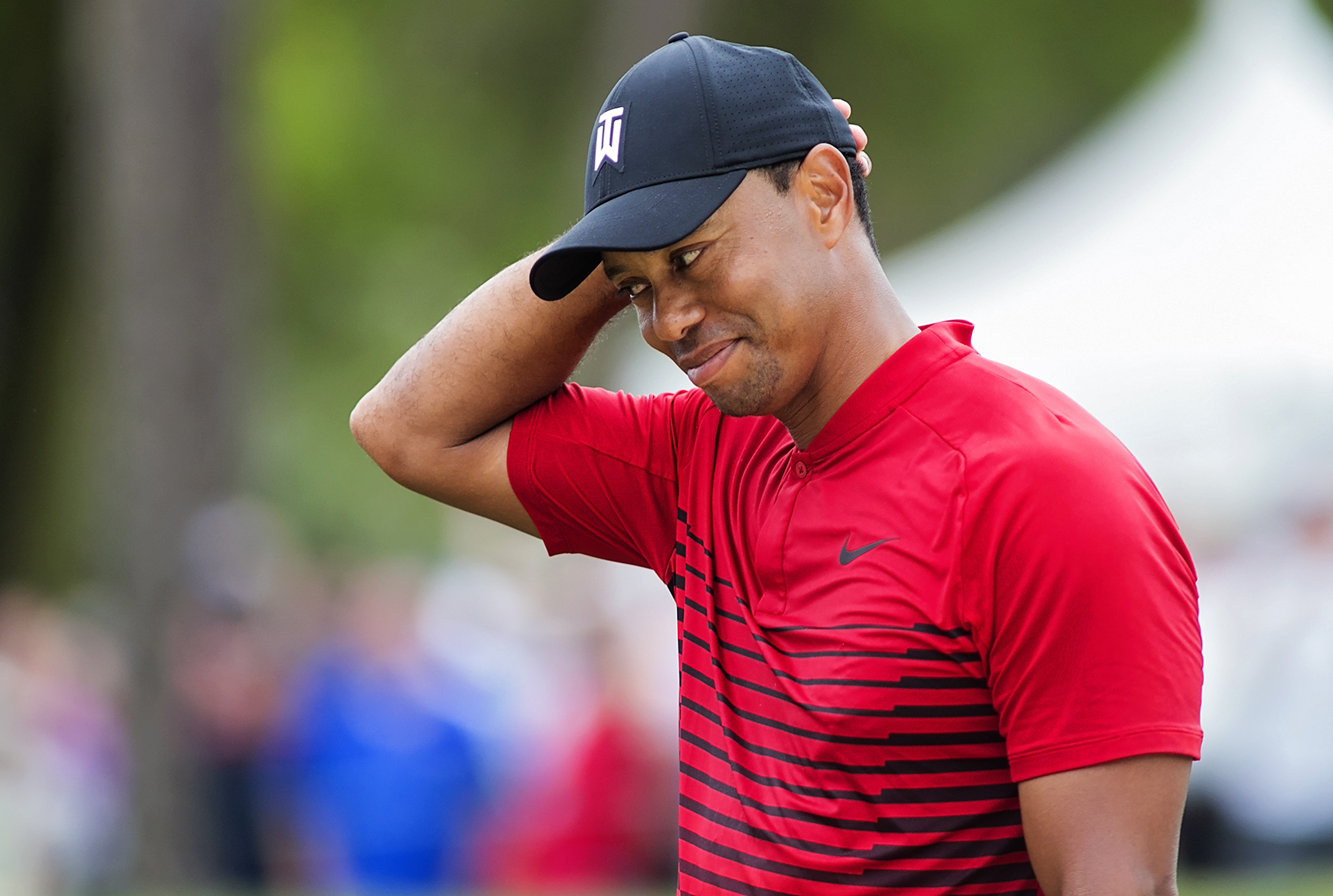 Woods didn't figure out his irons on Sunday./CARMEN MANDATO