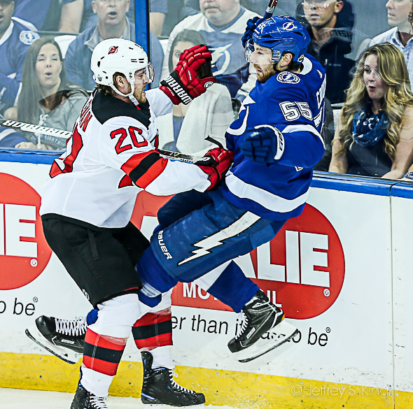 Braydon Coburn is checked against the boards./JEFFREY S. KING