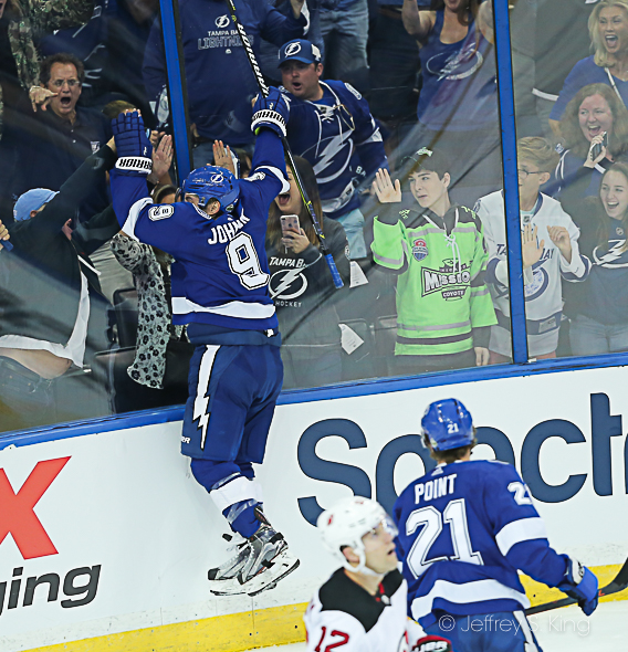 Tyler Johnson leaps after scoring./JEFFREY S. KING