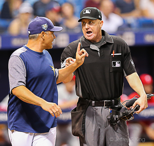 Cash makes a point with the umpires./JEFFREY S. KING
