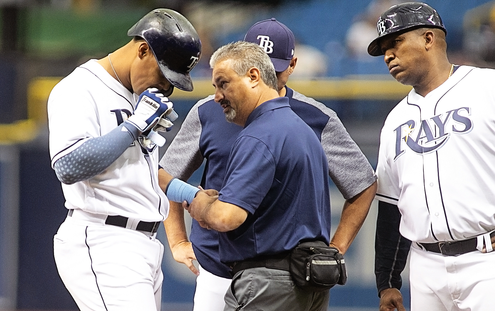 Gomez is examined after being hit by a pitch./CARMEN MANDATO