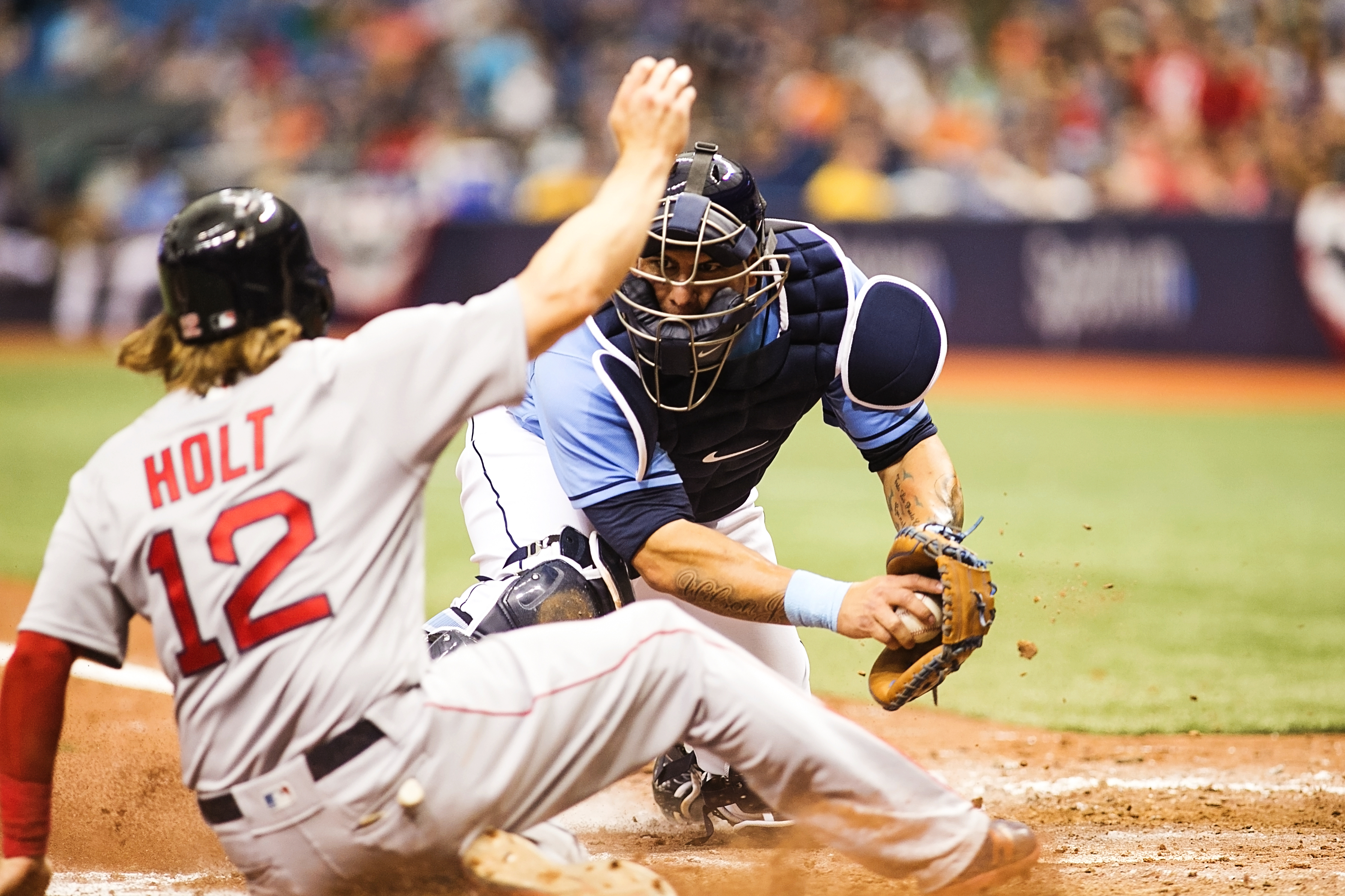 Ramos tags Holt out at the plate./CARMEN MANDATO