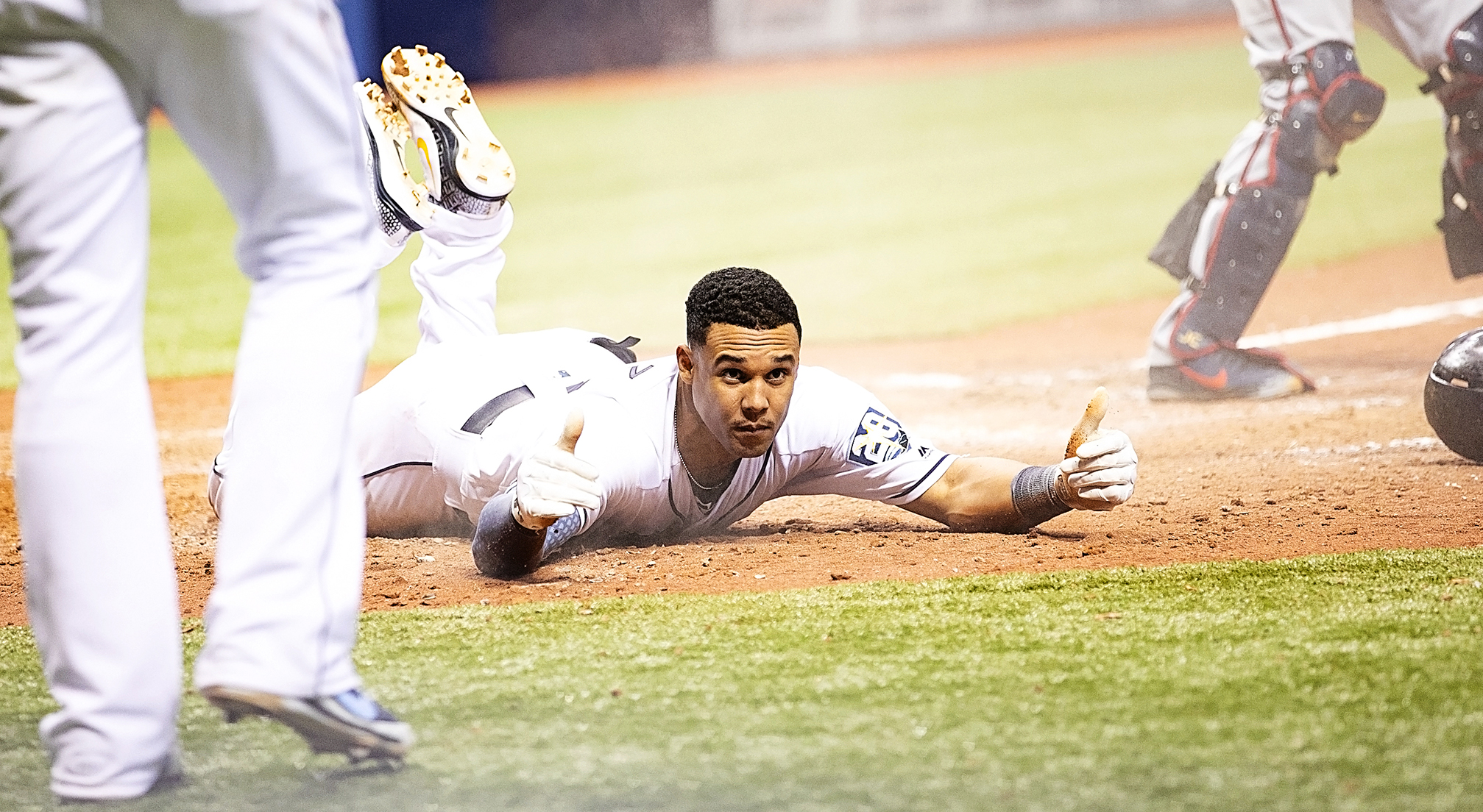 Carlos Gomez gives two thumb's up after scoring in the ninth./CARMEN MANDATO