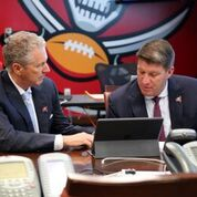 Koetter, Licht compare notes in the Bucs' War Room./PHOTO COURTESY OF TAMPA BAY BUCS