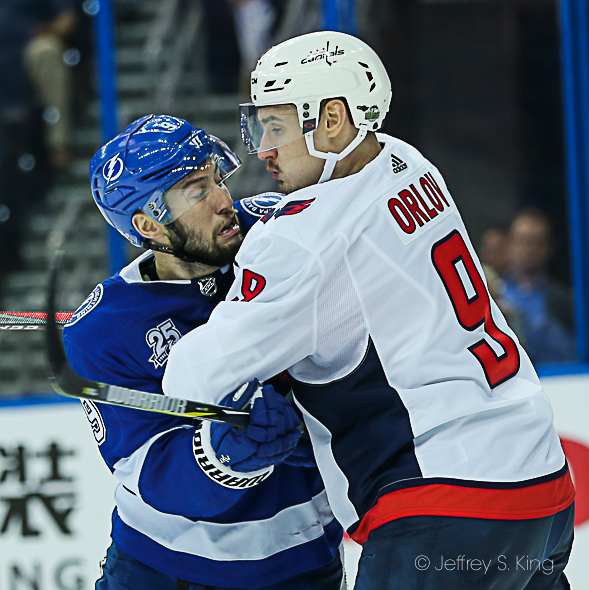 Tampa Bay's Tyler Johnson is outmuscled./JEFFREY S. KING